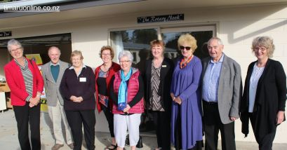 """Members of the Rotary Club of Timaru North, who funded and gave practical assistance to the project, in front of the """"Rotary Nook"""""""