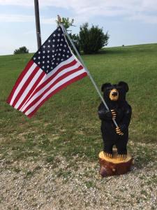 bear holding flag