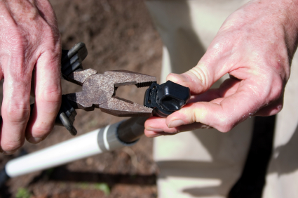Irrigation contractor in Walnut Creek adjusts a sprinkler valve during a zone addition
