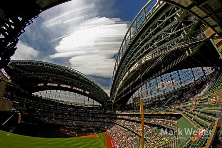 Timestack photography of clouds over stadium