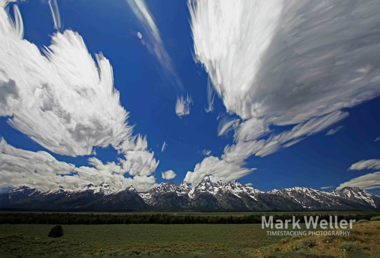 Timestack photography of clouds over mountains snow