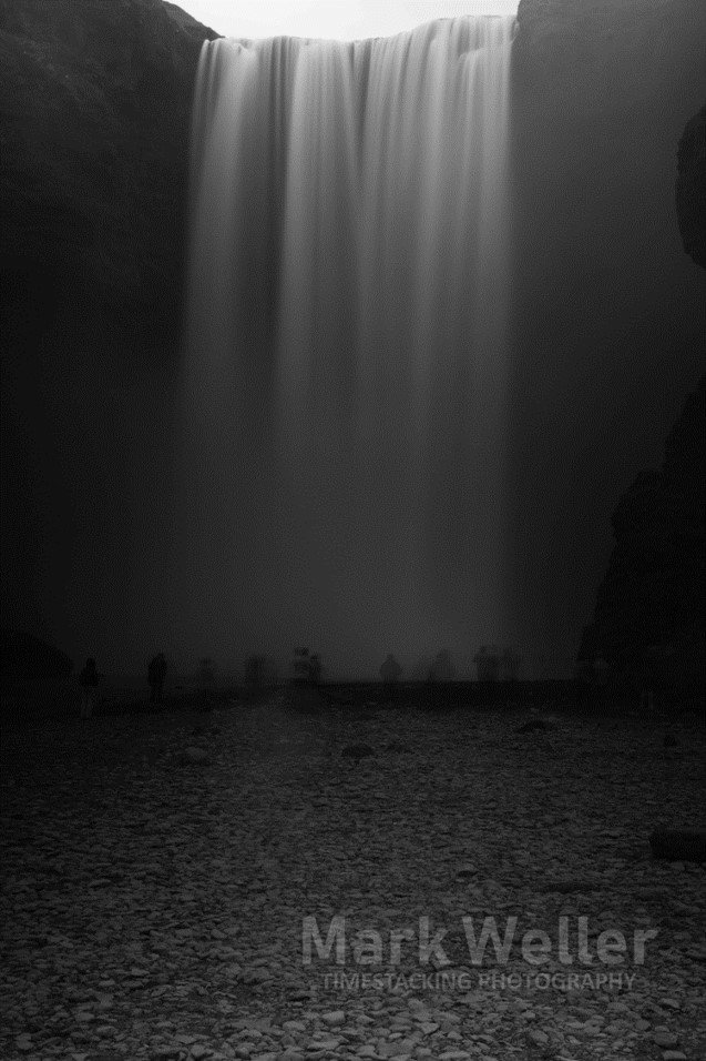 Timestack photography of black_and_white water fall people stones