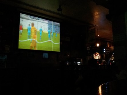 Day 222 Match time! First time watching with a newly created official Arsenal fan club in Bahrain. Happy days. PS. Yes, all pubs in Bahrain are this dark.