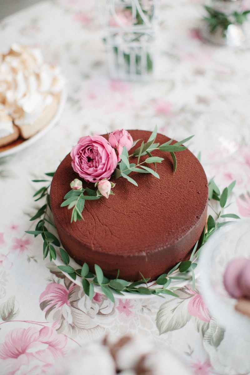 photo of chocolate cake with pink rose on top