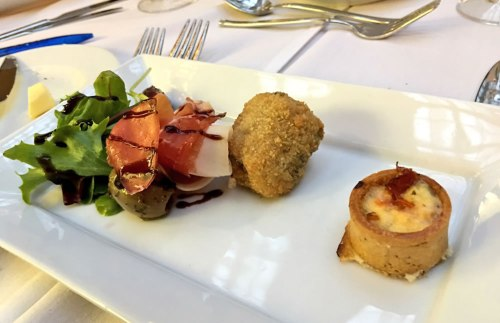 n olive salad with parma ham, a tomato pie and a risotto rissole