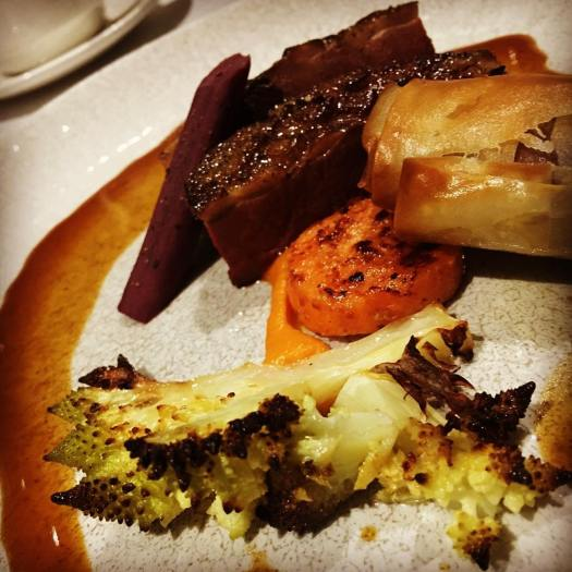 pan fried spiced Gressingham duck breast with a duck leg pastille, salsify, sweet potato and Romanesco