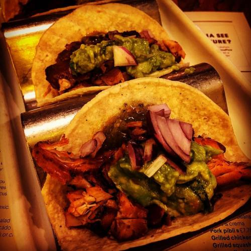 hree soft corn tortillas, grilled & filled with grilled chicken & avocado with ancho rub, guacamole & green tomatillo salsa