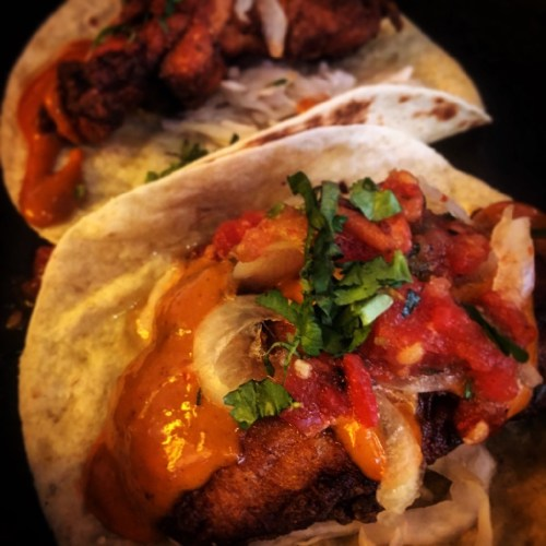 Buttermilk chicken Baja Tacos served crispy fried with habanero & white onion relish & spiced mayo