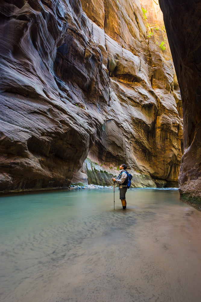 Hiking the Narrows of the Virgin River in Zion National Park.
