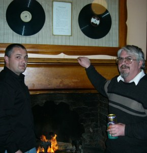 Bush Inn host Barry Dabin and historian Kim Roberts with the mounted recordings of the 1932 opera Maritana, produced and broadcast from the hotel.
