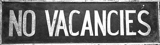 """Old """"No Vacancies"""" sign on a wall"""
