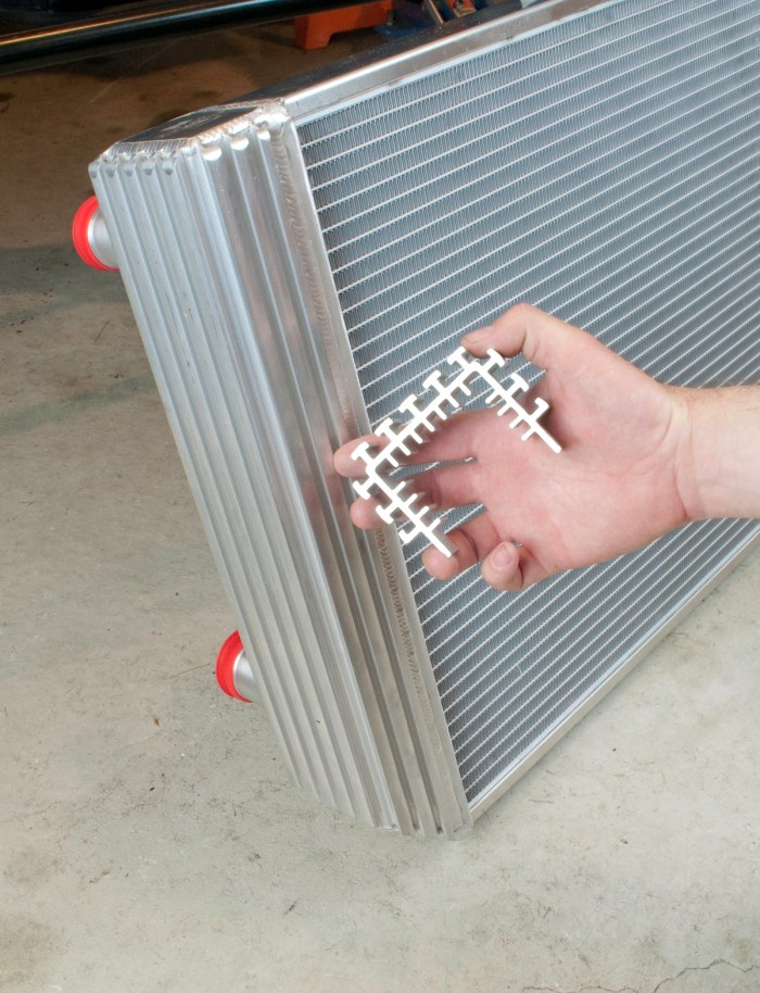 The Flex-a-fit radiator from Flex-a-lite features a patented sidetank design which incorporates cooling fins on the inside and outside. This significantly increases surface contact for better heat transfer. It also makes mounting the radiator brackets, an electric fan and other accessories a breeze, using T-bolts to slide into the channels.