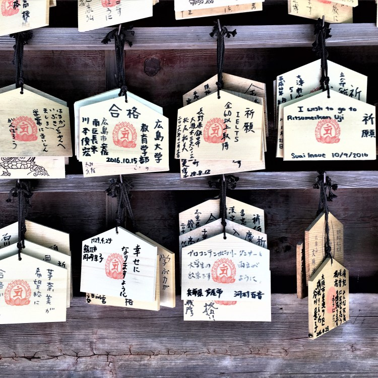 After paying respects at a Shinto shrine, follow the etiquette on Ema - you buy these wooden plaque to write your wishes and hang them to be received by the gods.