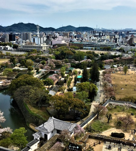 Spectacular views from the top floor of the Keep of the Castle grounds, view of the City and the mountains beyond.Ultimate 1 day guide to the best of Himeji, Japan