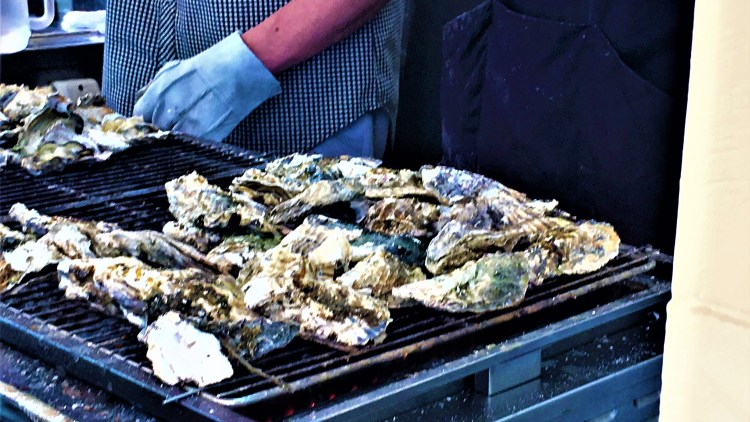 Yaki-gaki-grilled oysters. Open-air street food which you will find at every corner of high street in this Island.