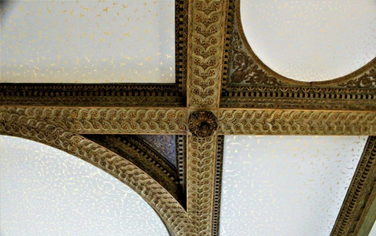 The intricate detail of the architecture of the ceiling in the Great Hall of the Queen's House.
