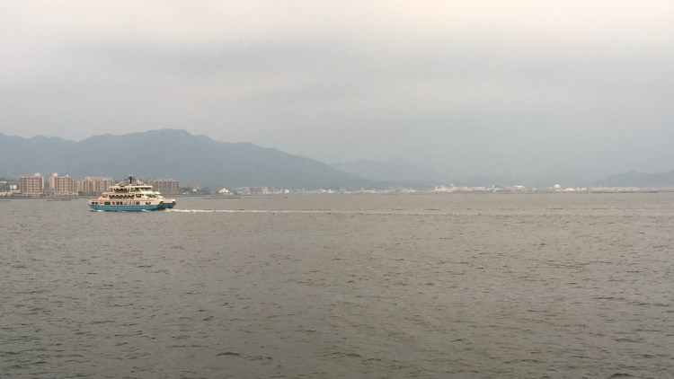 Miyajima Island: Watch the ferries come and go and the City of Hiroshima in the distance.