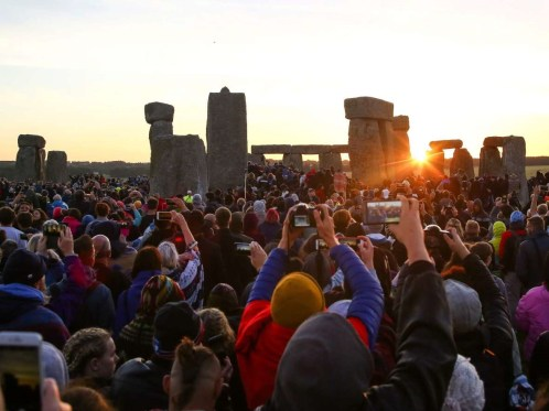 Revellers at Stonehenge watching the sunrise on summer solstice