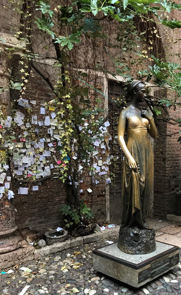 Little love notes cover the walls of the courtyard at Juliet's House, Romeo and Juliet, Verona