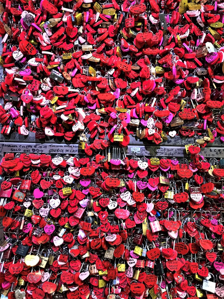 Love locks attached to railings inside the shops in Verona nearby to Juliet's House