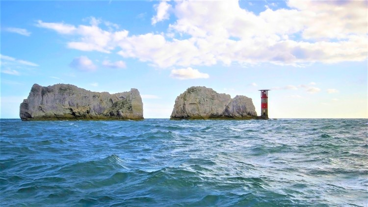 The Needles rocks and lighthouse viewed from a boat | Alum Bay Isle of Wight
