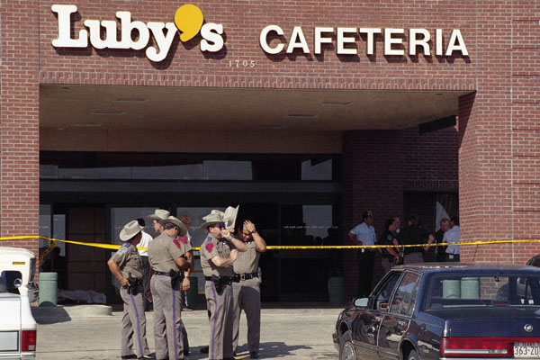 Police officers gather outside Luby's Cafeteria in Killeen, Texas
