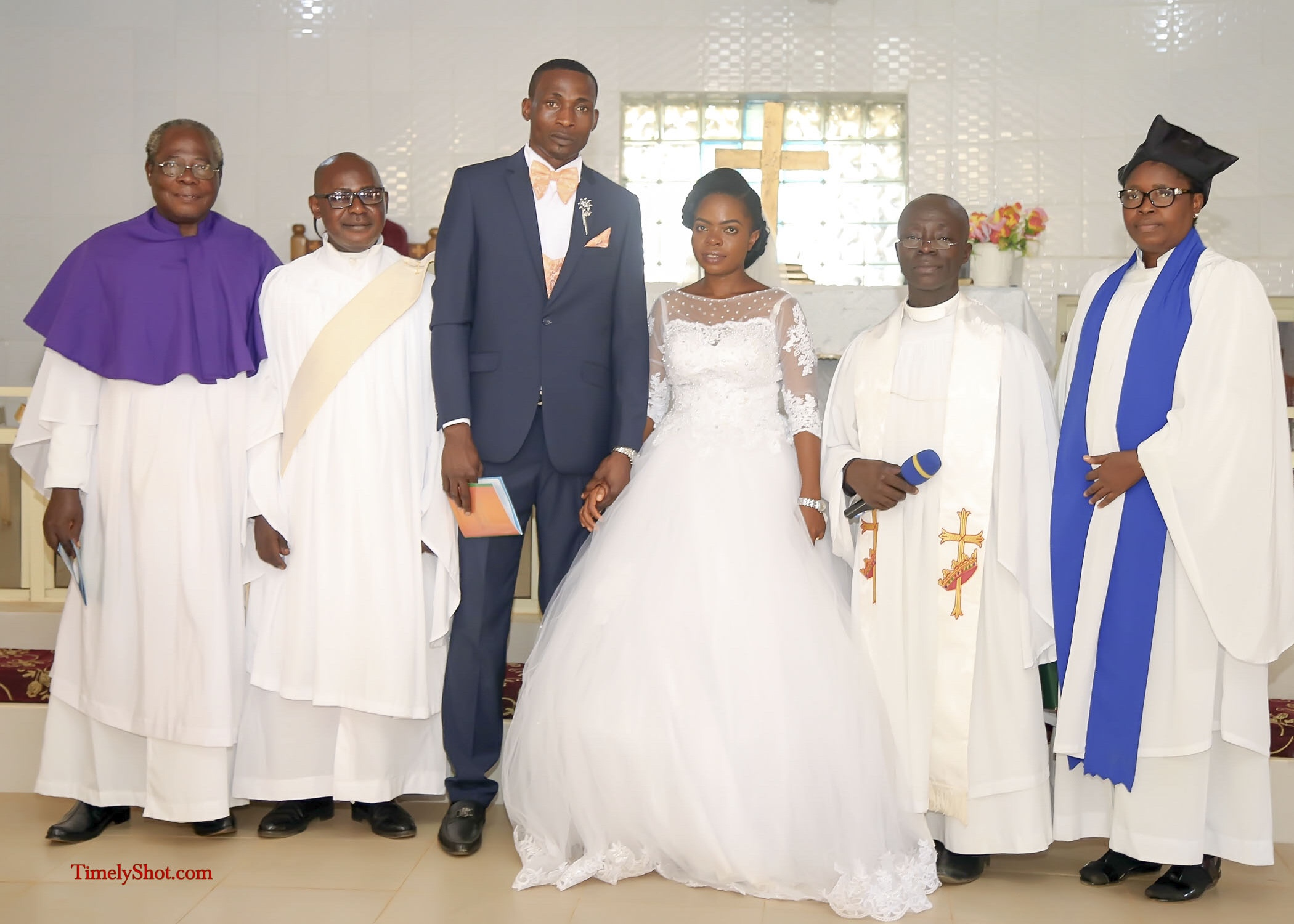couple with officiating ministers