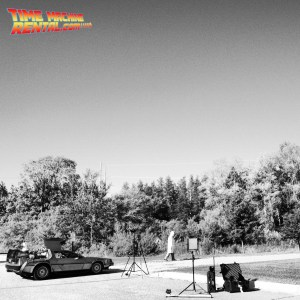 An artistic black and white rendition of the Doc Brown video shoot featuring the timemachinerental.com DeLorean Time Machine.