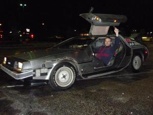 It's random Back to the Future fan sitting in the time machine cockpit.