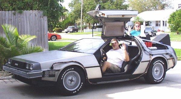 Original builder Doug Vaters hops into the DeLorean and waves hello.