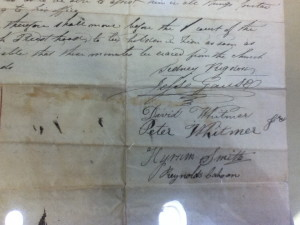After Peter Whitmer  signed this, the paper was folded-note the ink smudges opposite his signature-and then transported for Hyrum Smith and Reynolds Cahoon in a different ink.