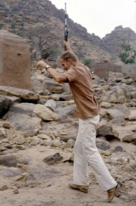 The author (younger!) dancing with a Dogon gun