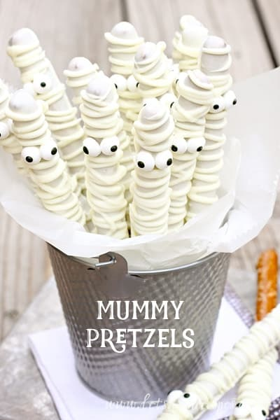 Delicious white chocolate mummy pretzels for kids. Funny trick and treat for Halloween. Halloween fun and candy filled ideas for kids. Halloween monster treat ideas for school kids. Find 22 more delicious Halloween dessert ideas for fun party. Halloween dessert recipes for children. Best Halloween treat ideas for adults. Cute Halloween dessert recipes for party. Easy to make Halloween spooky foods ideas for kids. Halloween monster eyes treat for kids. Easy Halloween food ideas for party. Easy Halloween treats for kids. Halloween tricks and treats for school parties.