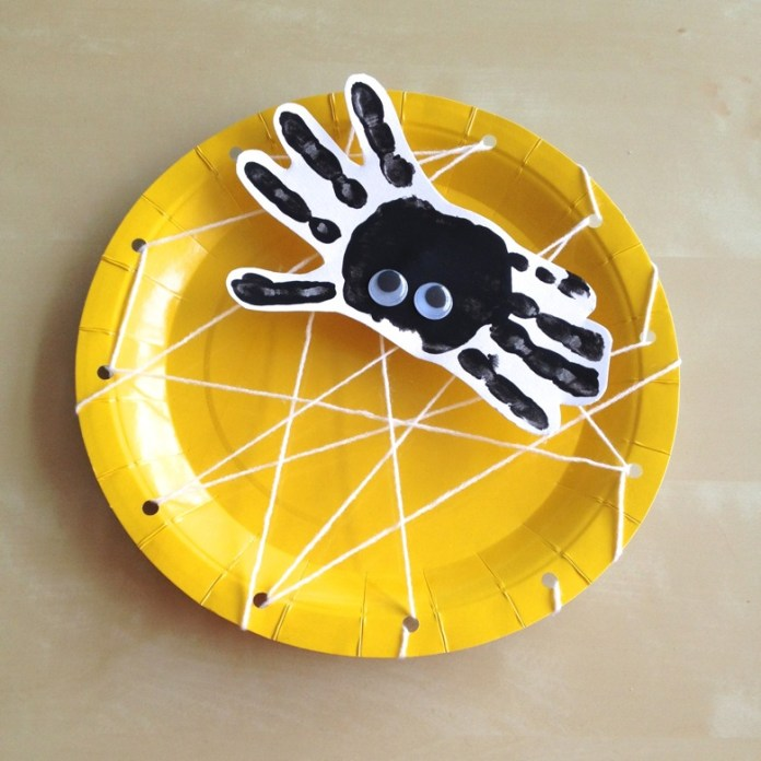 Create your own spider webs using hole-punched paper plates and yarn on Halloween. Try 15 more simple and easy crafts ideas for kids to decorate party and enjoy evening.