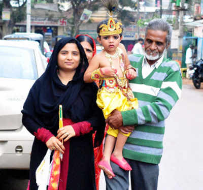 Muslim family carries son playing Hindu avatar Krishna