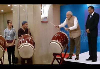 In Tokyo, Modi plays taiko drums, breaks security cordon ...