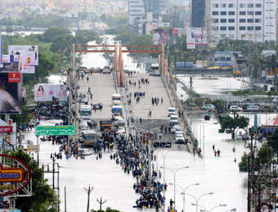 "Google's Crisis Response tool ""South India Flooding"" important information like emergency helpline numbers and maps of crowdsourced flooded streets."