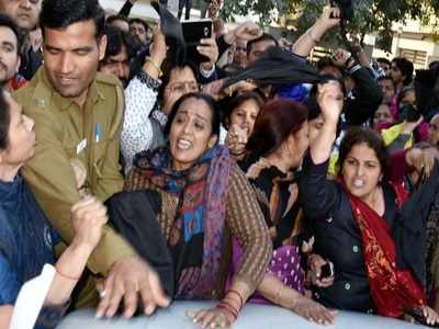 Women protest at Asha Kiran Home.