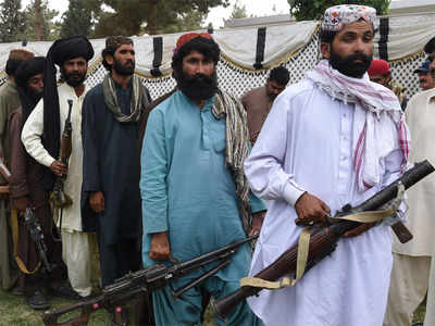 Baloch militants carry their weapons as they prepare to surrender to Pakistani security forces in Quetta.