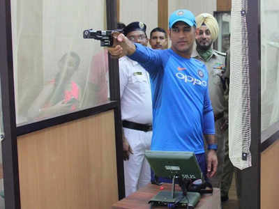 Image result for MS Dhoni wows cops with marksmanship