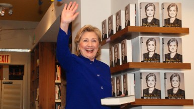 Hillary Clinton reacts as fans cheer her 8:30 a.m. arrival at the Warwick's book-signing.