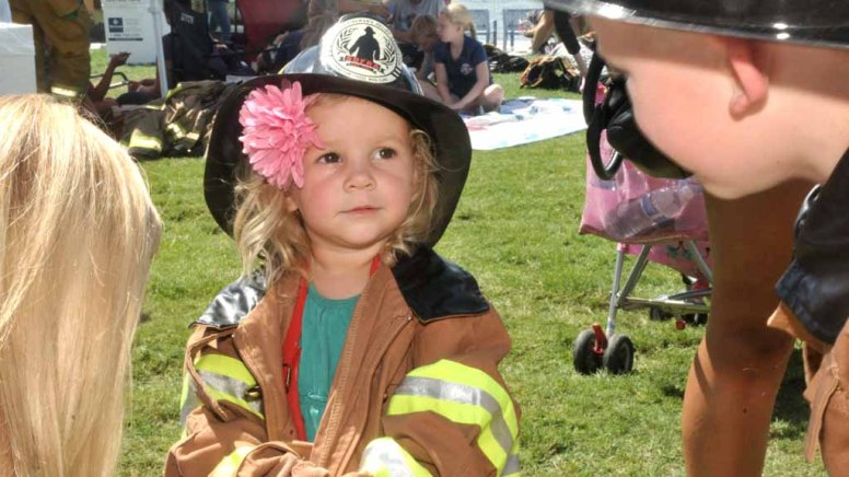 Braelyn Ackerman, 2, gets dressed in firefighter clothes for the Teddy Bear rescue.