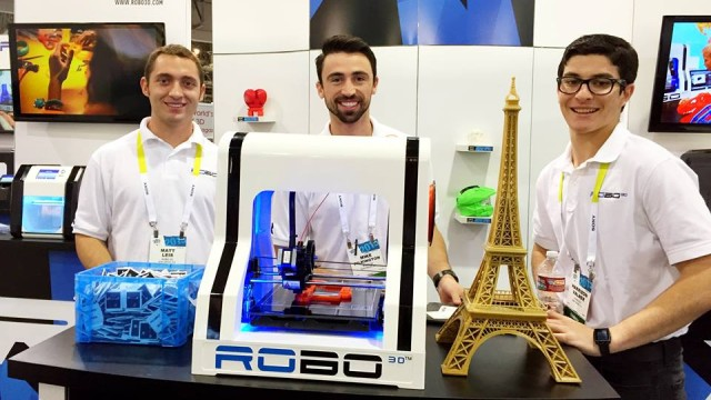 ROBO 3D staff with the R1 printer and the Consumer Electronics Show in Las Vegas. Photo courtesy ROBO 3D