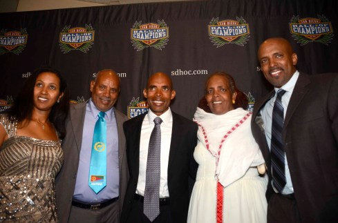 Boston Marathon champion Meb Keflezighi poses with his family at the San Diego Hall of Champions' Salute to Champions