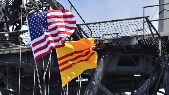 U.S. and Vietnamese flags are raised aboard the USS Midway