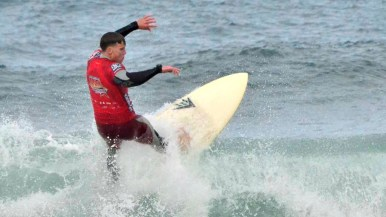 Benjamin Cole, a Marine who recently returned from a deployment in Afghanistan, enjoys the surf.