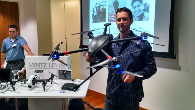 Chad Amonn, CEO and co-founder of INOVA Drone, with the company's prototype drone for public safety uses. Photo by Chris Jennewein