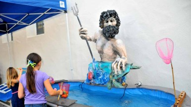 """A Poseidon fishing game was among the Greek """"Olympic Games"""" at the festival. Photo by Chris Stone"""