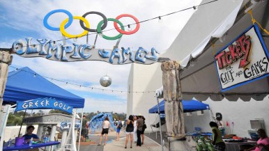 """""""Olympic Games"""" for youngsters included miniature golf and tossing games at the festival. Photo by Chris Stone"""