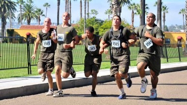 Arm in arm, a team finishes the Boot Camp Challenge. Photo by Chris Stone
